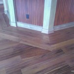 Teak floor in game room with inlay around bar