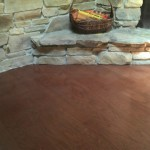 wood installed by stone fireplace which was undercut