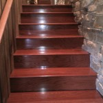 wood steps by stone wall