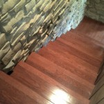 wood steps by stone wall- descending